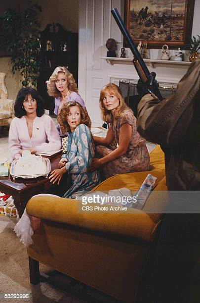 American actresses Michele Lee Donna Mills Kim Lankford and Constance McCashin cower from a partially visible shotgunwielding person in the episode...