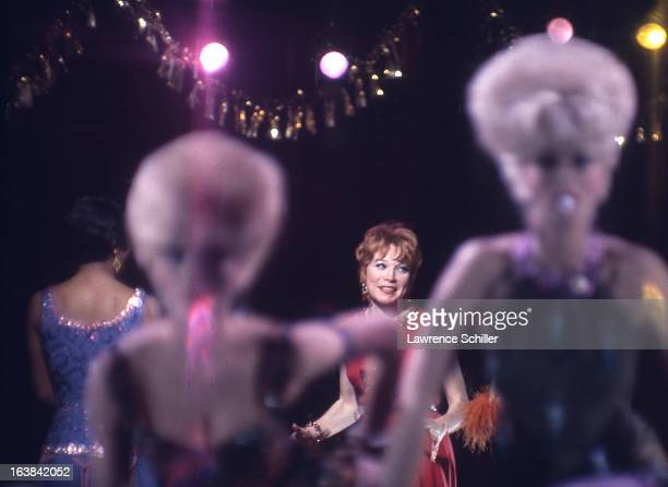 American actresses Paula Kelly and Shirley MacLaine perform with unidentified others in a scene from the film 'Sweet Charity' at Universal Studios...