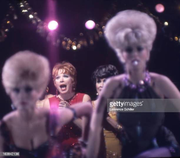 American actresses Shirley MacLaine and Chita Rivera perform with unidentified others in a scene from the film 'Sweet Charity' at Universal Studio...