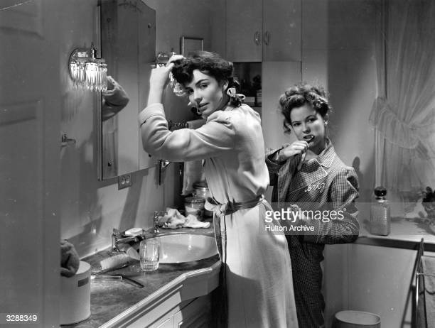 American actresses Shirley Temple and Jennifer Jones in a bathroom scene from the film 'Since You Went Away' directed by John Cromwell for United...