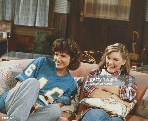 American actresses Susan Saint James and Jane Curtain relax on a couch in a still from the CBS television sitcom 'Kate & Allie,' New York, New York,...