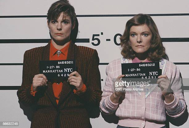 American actresses Susan Saint James and Jane Curtin pose for mugshots in a scene from the television sitcom 'Kate Allie' New York New York 1988