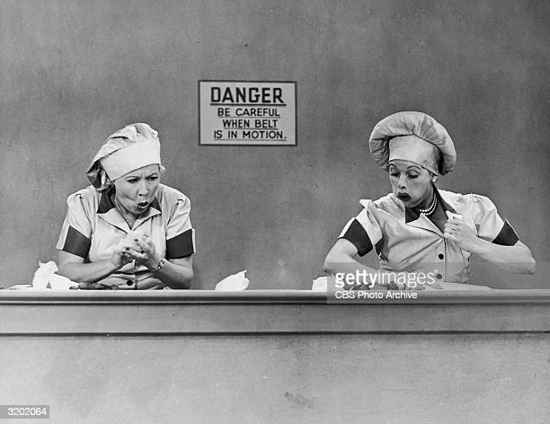 American actresses Vivian Vance , as Ethel Mertz, and Lucille Ball , as Lucy Ricardo, work side-by side at a candy factory conveyor belt in an...