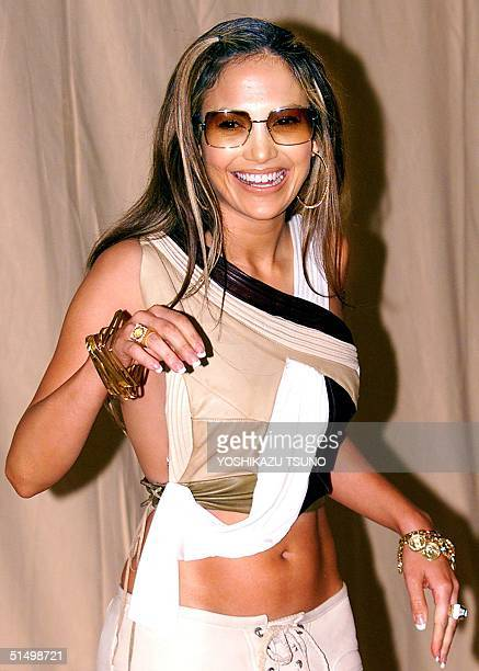 American actresssinger Jennifer Lopez reacts to photographers during a photo session prior to her press conference at a Tokyo hotel 16 February 2001...