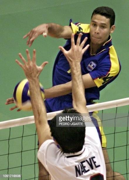 American Adam Naeve tries to stop a shot from Colombian Diego Escobar during the volleyball competition of the Pan Am games 26 July 1999 Adam Naeve...