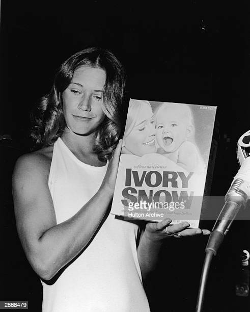 American adult film actor Marilyn Chambers holds a box of Ivory Snow laundry detergent circa 1974