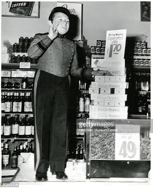 American advertising pitchman Johnny Roventini stands on a counter in his bellhop uniform to deliver a 'Call for Phillip Morris' the tobacco...