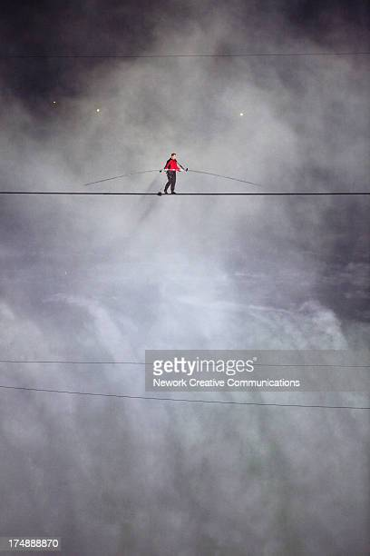 American aerialist Nik Wallenda walks a tightrope across the Horseshoe Falls between Niagara Falls, New York, and Niagara Falls, Ontario, Canada....