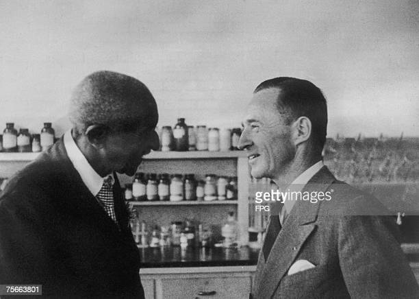 American agricultural chemist and educator Dr George Washington Carver with American industrialist Edsel Ford of the Ford Motor Company at Henry...