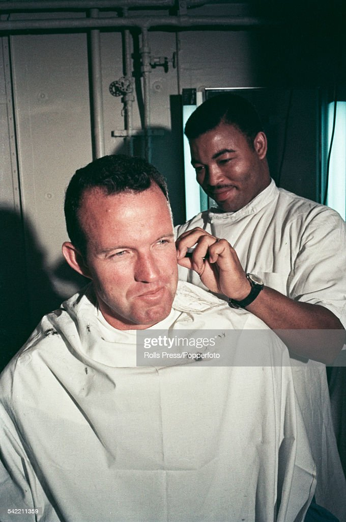 American Air Force test pilot and astronaut, Gordon Cooper (1927-2004) pictured receiving a haircut from a barber on the USS Kearsarge carrier following his Mercury-Atlas 9 space mission in May 1963.