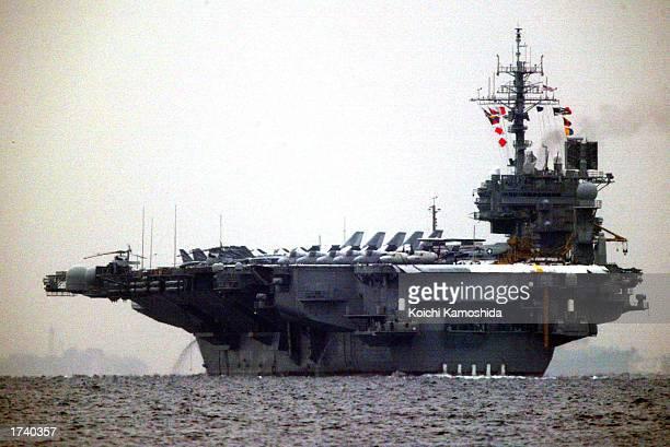 American aircraft carrier USS Kitty Hawk leaves Yokosuka naval base to monitor North Korea January 23, 2003 in Yokosuka, Japan.