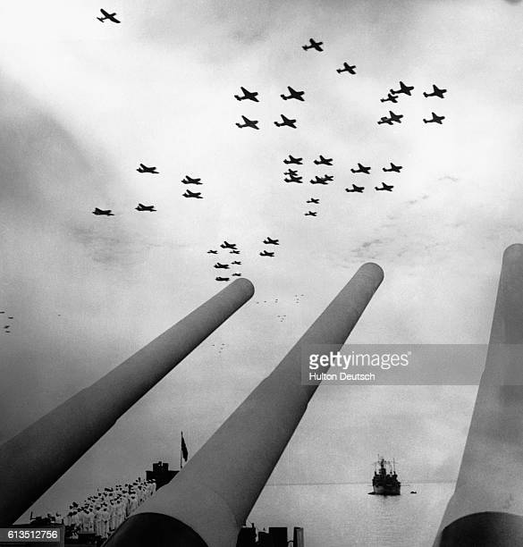 American aircraft flying over the battleship Missouri in Tokyo Bay during the surrender ceremony on V-J Day, Japan, 2nd September 1945.