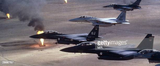 American airforce F15 C fighters flying over a Kuwaiti oilfield which had been torched by retreating Iraqi troops during the Gulf War