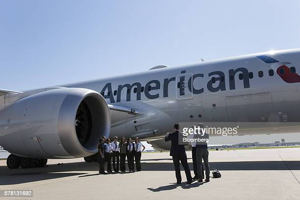 American Airline Inc staff stand for a photograph in front of an aircraft at DallasFort Worth International Airport during a recruiting event in...
