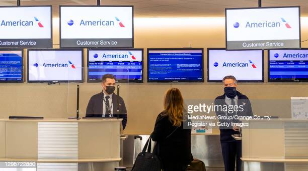 American Airlines agents check in a passenger at John Wayne Airport in Santa Ana, CA on Tuesday, January 26, 2021. Passenger traffic at JWA was down...