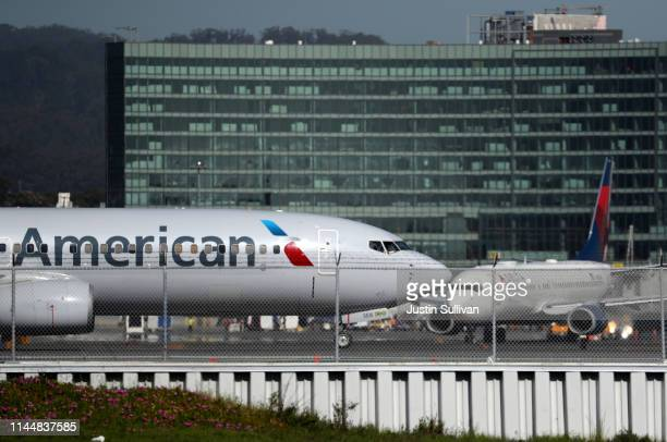 American Airlines and Delta Airlines Boeing 737s taxi on the runway at San Francisco International Airport on April 24 2019 in San Francisco...