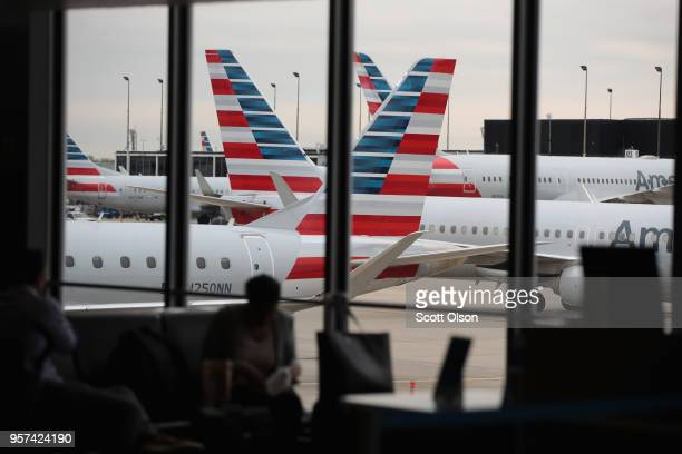 American Airlines aricraft sit at gates at O'Hare International Airport on May 11 2018 in Chicago Illinois Today American Airlines held a ceremony to...