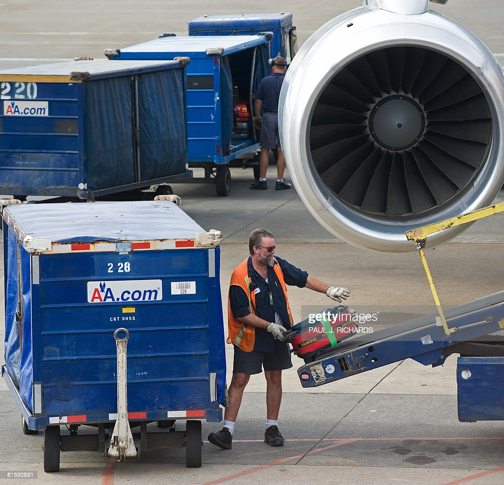 American Airlines Baggage Handlers Load Luggage On To A
