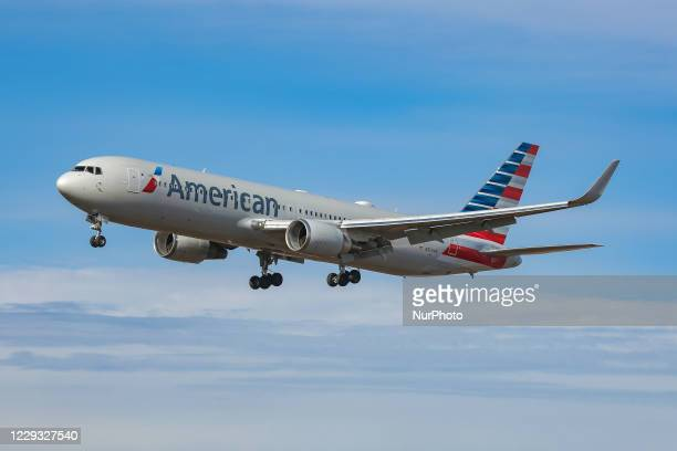 American Airlines Boeing 767 aircraft as seen flying on final approach for landing at New York John F. Kennedy International Airport JFK in New York,...