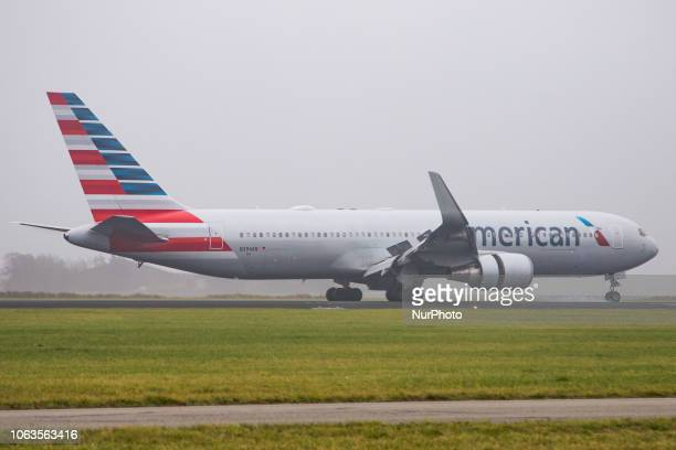 American Airlines Boeing 767300 landing in the mist in Amsterdam Schiphol International Airport American connects Amsterdam to Philadelphia and...