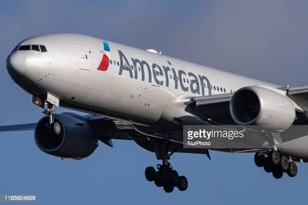 American Airlines Boeing 777200 aircraft seen flying on final approach while landing at London Heathrow International Airport LHR EGLL in England UK...