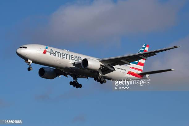 American Airlines Boeing 777-200 aircraft seen flying on final approach, while landing at London Heathrow International Airport LHR EGLL in England,...