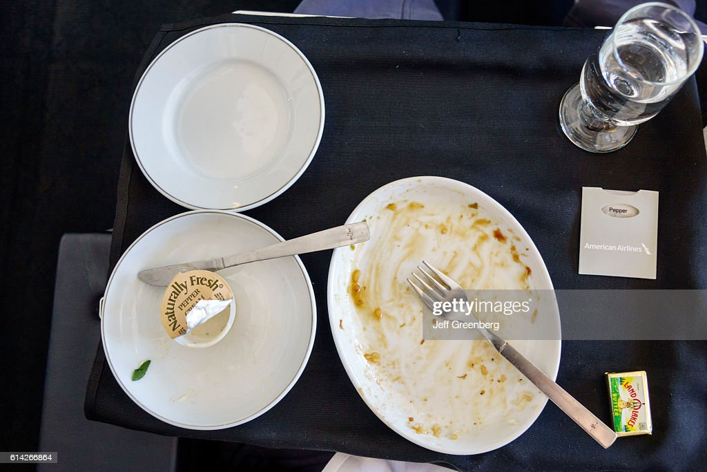 American Airlines, business class, empty plates. : News Photo