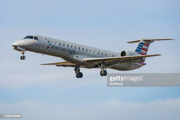 American Airlines Embraer ERJ-145 regional jet aircraft as seen on final approach landing at New York JFK international airport in NY, USA on...