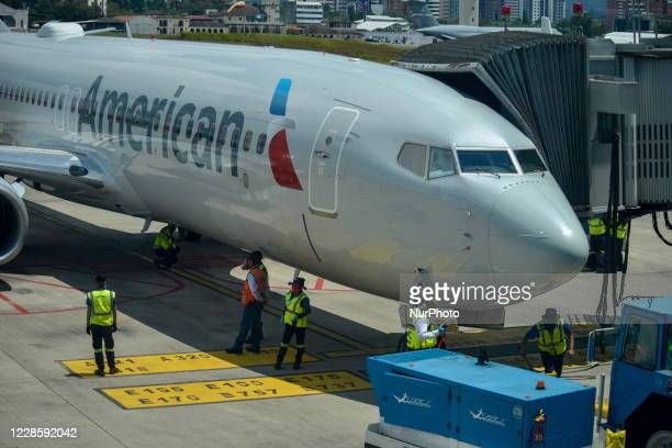 American Airlines employees check their plane after landing at La Aurora International Airport, in Guatemala City, Guatemala on Friday, September 18....