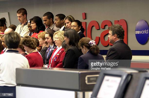American Airlines employees observe a moment of silence at the American Airlines Terminal honoring those who were lost during the terrorist attacks...