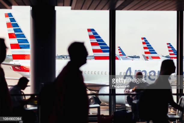 american airlines fleet of airplanes with passengers at o'hare airport - american airlines stock pictures, royalty-free photos & images