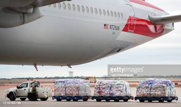 American Airlines fleet services employees prepare to load cargo pallets on a 777300 at Dallas/Fort Worth International Airport bound for Frankfurt...
