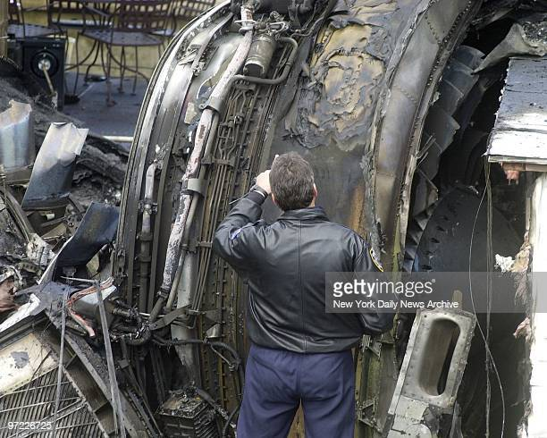 American Airlines flight 587 crashed with 270 poeple aboard.. Views of Aircraft engine that fell in backyard of home 418 Beach 130, that hit house...