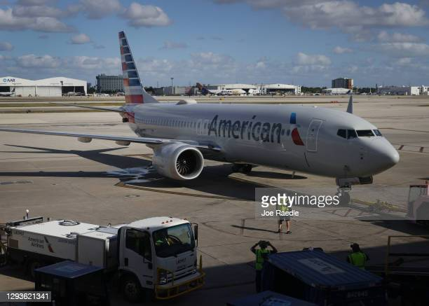 American Airlines flight 718, a Boeing 737 Max, is pushed back from its gate at Miami International Airport on its way to New York on December 29,...