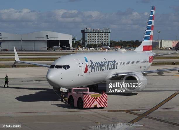 American Airlines flight 718, a Boeing 737 Max, pulls away from its gate at Miami International Airport on its way to New York on December 29, 2020...