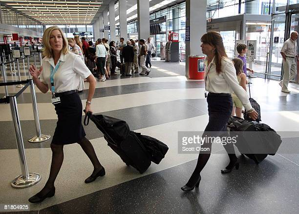 American Airlines flight attendants arrive for work at O'Hare International Airport July 2 2008 in Chicago Illinois American Airlines says it may cut...