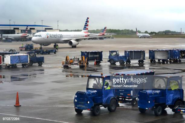 American Airlines ground crew members service commercial aircraft landing and arriving at Charlotte Douglas International Airport in Charlotte North...