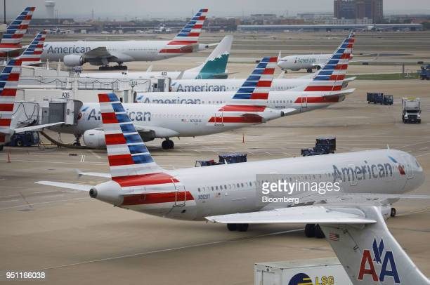 American Airlines Group Inc planes stand at DallasFort Worth International Airport in Grapevine Texas US on Friday April 6 2018 American Airlines is...