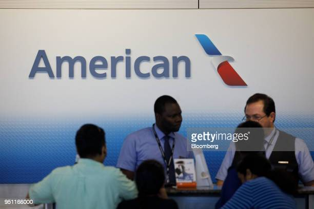 American Airlines Group Inc signage is displayed as employees checkin travelers at DallasFort Worth International Airport in Grapevine Texas US on...
