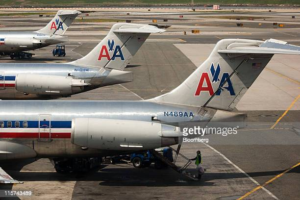 American Airlines Inc McConnell Douglas MD82 front and McConnell Douglas MD83 center and back planes stand by gates at LaGuardia Airport in the...