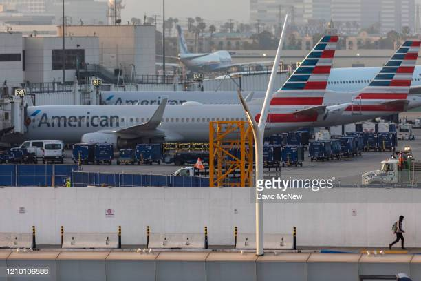 American Airlines jets are seen at a nearly deserted Los Angeles International Airport due to the coronavirus pandemic on April 16 2020 in Los...
