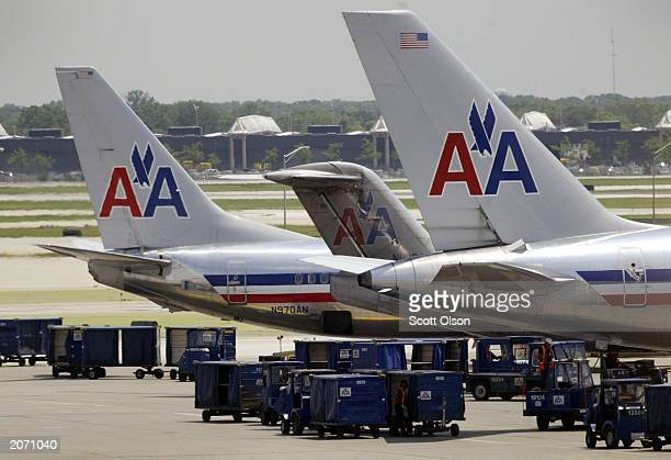 American Airlines jets sit on the tarmac at O'Hare Airport June 10, 2003 in Chicago, Illinois. Moody's, the credit rating service, said June 9 that...