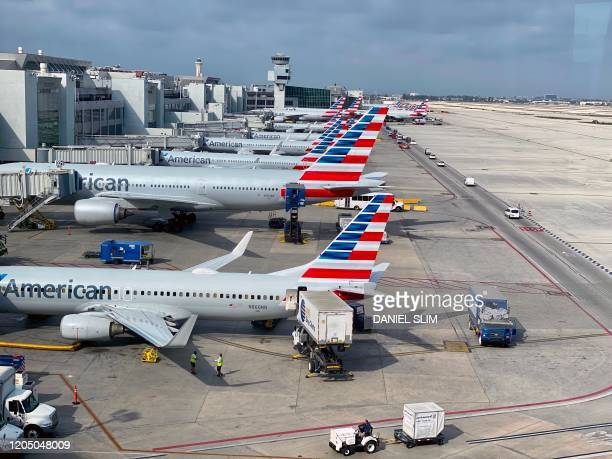 American Airlines planes are seen at Miami International Airport on March 3 2020 in Miami Florida