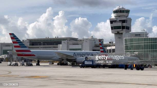American Airlines planes are seen at the gates at Miami International Airport on August 1, 2021 in Miami, Florida.