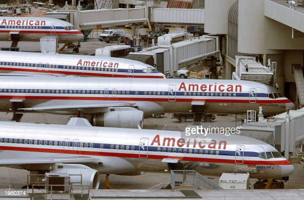 American Airlines planes sit at a Miami International Airport terminal October 16 2002 in Miami Florida Embattled American Airlines chief Donald J...