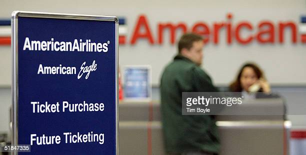 American Airlines signage is seen near the ticket counter in its terminal December 10 2004 at O'Hare International Airport in Chicago Illinois...