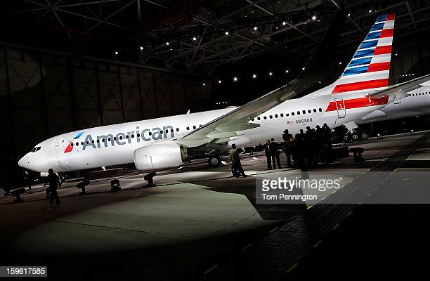 American Airlines unveils a new company logo and exterior paint scheme on a Boeing 737800 aircraft on January 17 2013 in Dallas Texas The exterior...