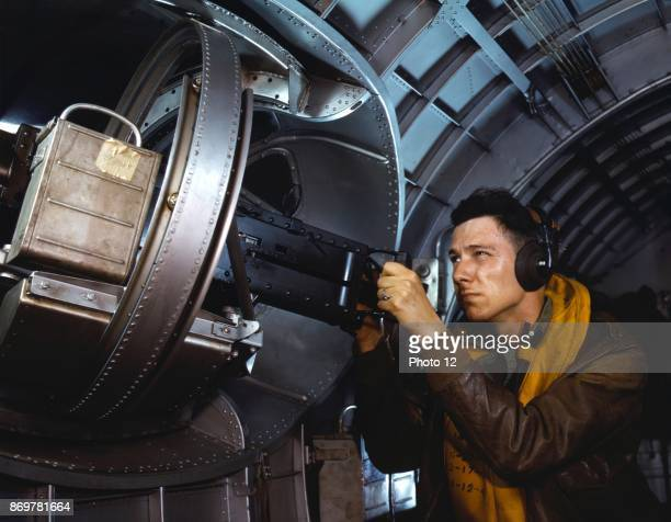 American airman using a a side machine gun of a B17 Flying Fortress bomber May 1942 World war two