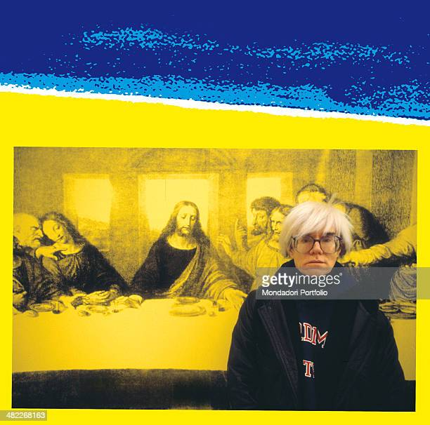 American allround artist Andy Warhol icon of the Pop Art Movement poses in front of The Last Supper a personal interpretation the American artist...