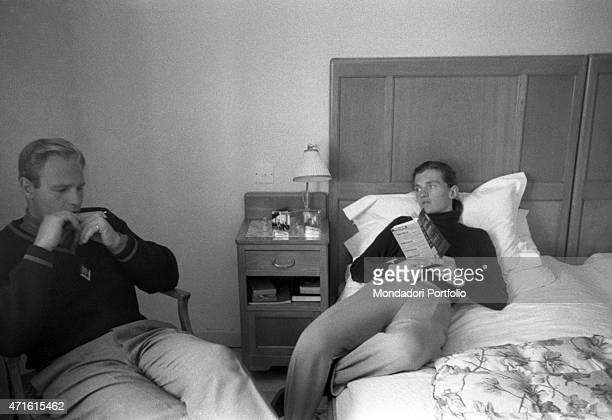 American alpine ski racer Andrea Mead Lawrence and her husband American alpine ski racer David J Lawrence relaxing in the hotel room during a break...